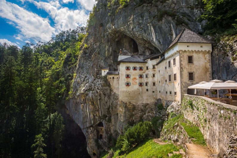 9-places-to-see-in-slovenia-the-predjama-castle-near-the-postojna-cave.jpg