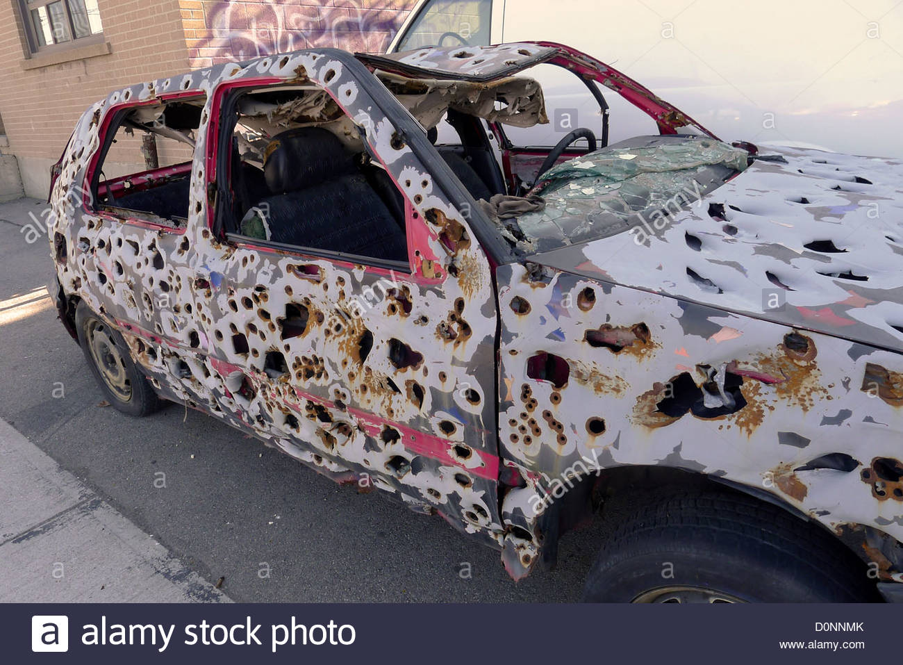 a-bullet-riddled-car-once-used-in-a-toronto-art-installation-D0NNMK.jpg