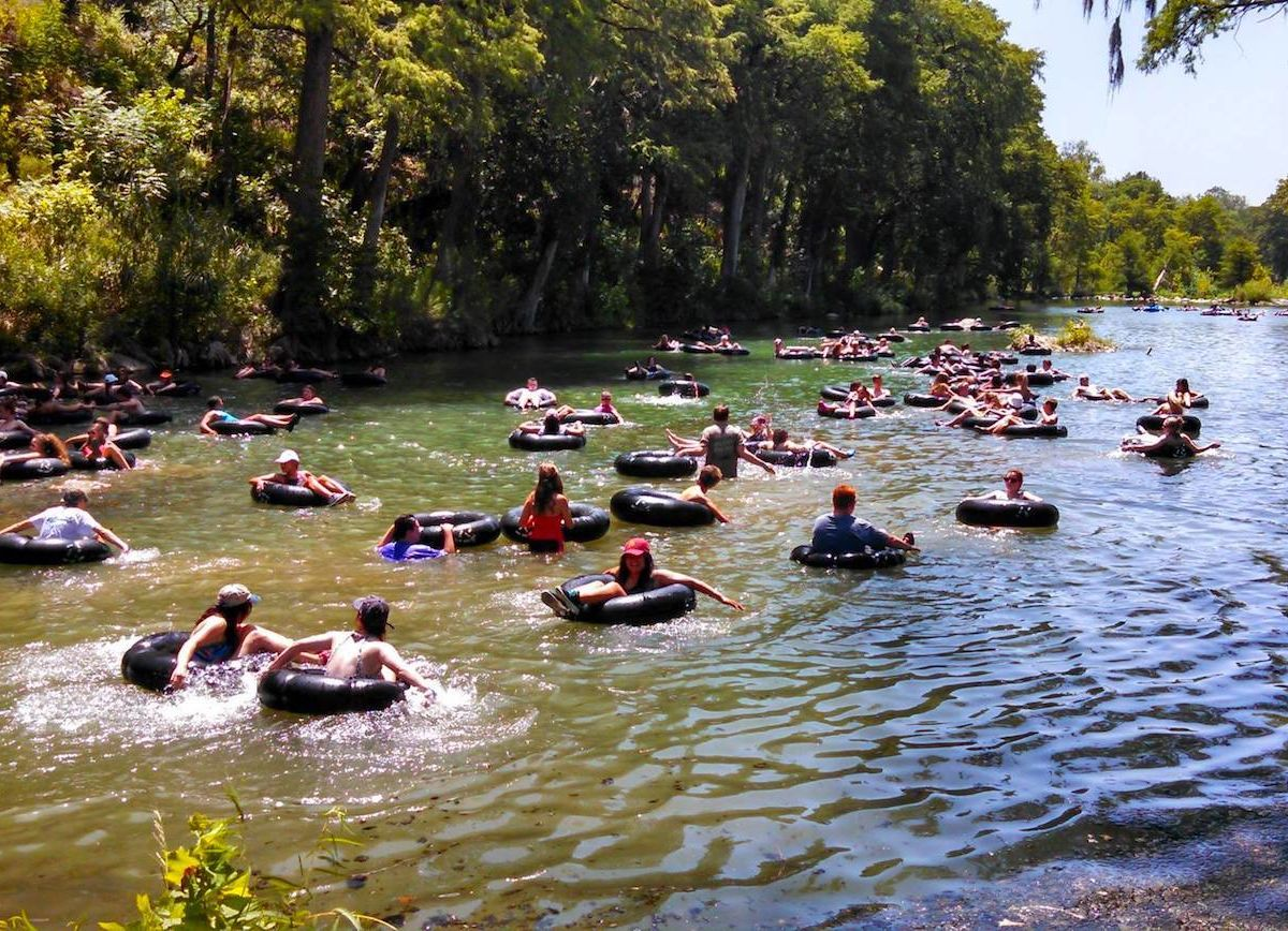 People-tubing-down-a-river-1200x868.jpg